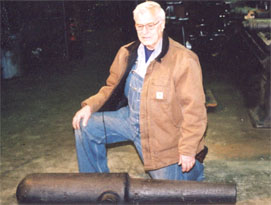 """Chuck Wiard, descendant of family that includes gunmakers Tohomas Wiard and Norman Wiard, and Wiard foundry and plow industries, examines 2.6"""" Wiard in SBR shop for bore restoration with Paulson sleeve."""